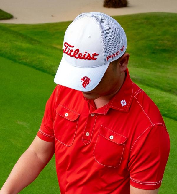 Red and White Collection cap front on course