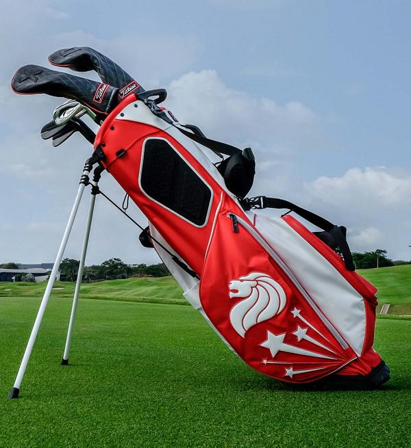 Red and White Collection Bag on course