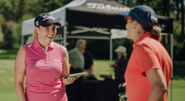Golfer talking to fitting expert about club fitting