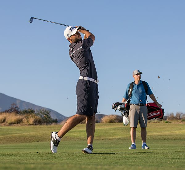 Golfer taking swings for Golf Club Fitting