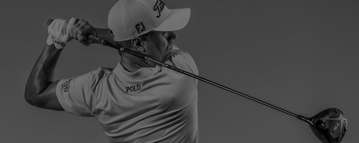 Justin Thomas swinging golf club