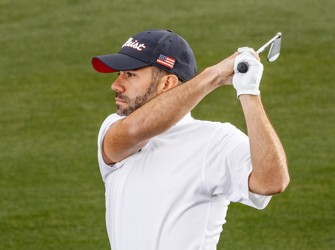 Golfer in Red, White and Blue Titleist Hat