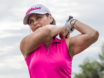 Lady Golfer in White and Pink Titleist Hat