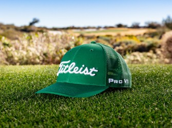 Titleist Green Out Snapback Mesh sitting on a tee box