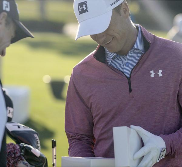 Jordan Spieth opening white box of New 2019 Pro V1 golf balls