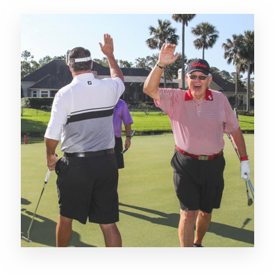 Golfers high-fiving