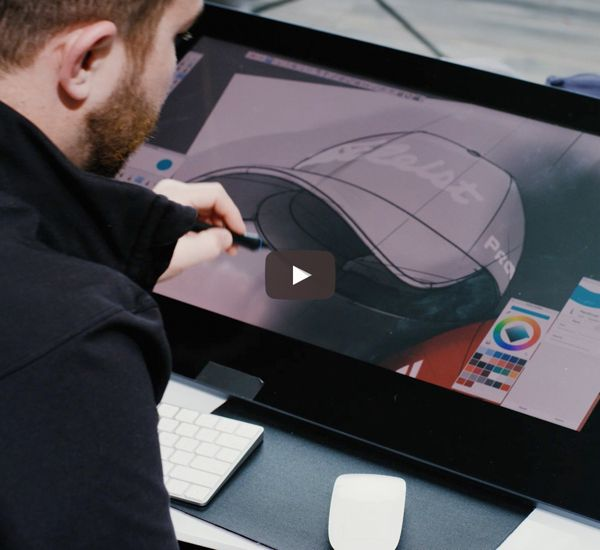 Designer drawing hat on computer