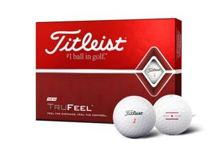 Titleist DT TruFeel Dozen Box with two golf balls, one with alignment aid logo